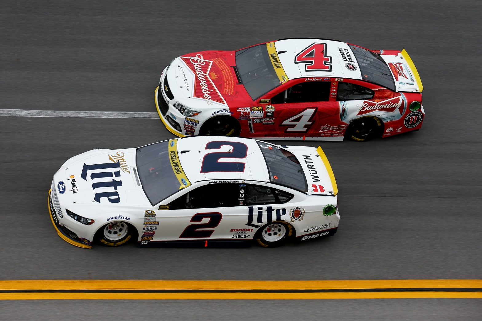 Two NASCARs sponsored by Bud and Lite