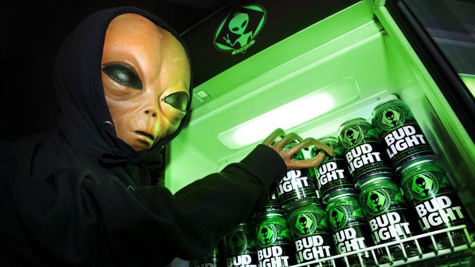 alien grabbing a bud light out of a fridge